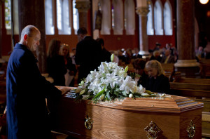 A mourners lays his hands on the coffin of Nobel Laureate poet Seamus Heaney before his funeral at the Sacred Heart Church in Donnybrook in south Dublin.